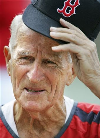 **FILE** Boston Red Sox great Johnny Pesky lifts his cap Aug. 31, 2006, during a television interview before a baseball game against the Toronto Blue Jays in Boston. Pesky, who spent most of his 60-plus years in pro baseball with the Red Sox and was beloved by the team's fans, died Aug. 13, 2012, in Danvers, Mass. He was 92. (Associated Press)