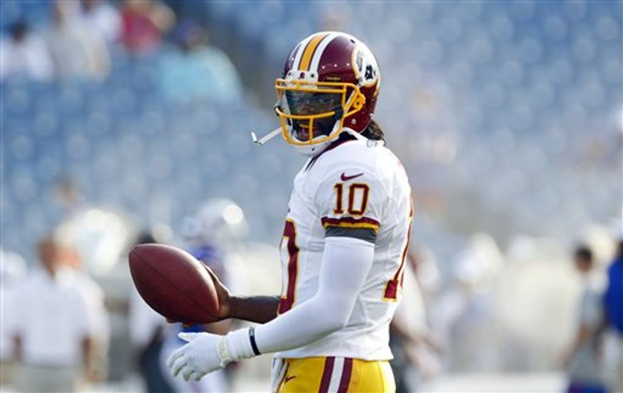 Robert Griffin III went 4-for-6 for 70 yards and a touchdown in his Washington Redskins preseason debut. (Associated Press)
