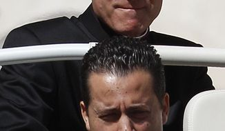 ** FILE ** Paolo Gabriele (bottom), Pope Benedict XVI's butler, is pictured with Monsignor Georg Gaenswein, the pontiff's personal secretary, on Wednesday, April 18, 2012. (AP Photo/Alessandra Tarantino)