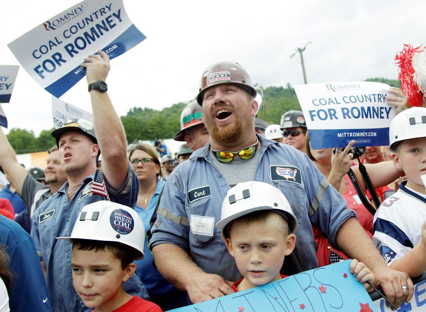A coal miner cheers as former Massachusetts Gov. Mitt Romney, the presumptive Republican presidential nominee, speaks during an event at the American Energy Corporation in Beallsville, Ohio, on Tuesday. The United Mine Workers of America has yet to make a decision about endorsing President Obama. (Associated Press)