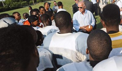 Vice President Joe Biden pays the George Washington High School football team a surprise visit on Monday, Aug. 13, 2014, in Danville, Va. (AP Photo/The Register & Bee, Steven Mantilla) ** FILE **