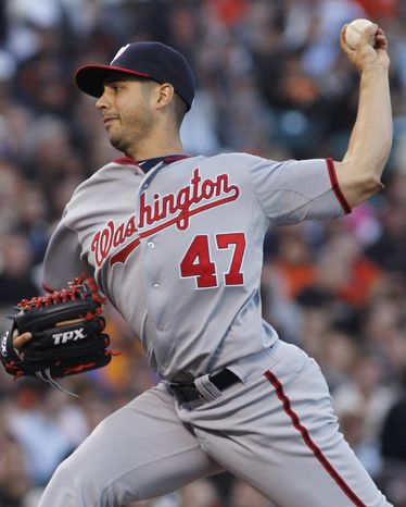 Washington Nationals pitcher Gio Gonzalez throws to the San Francisco Giants during the first inning of a baseball game, Monday, Aug. 13, 2012, in San Francisco, Calif. (AP Photo/George Nikitin)
