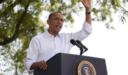 President Obama speaks Aug. 14, 2012, during a campaign event at the Nelson Pioneer Farm & Museum in Oskaloosa, Iowa, during a three-day campaign bus tour through Iowa. (Associated Press)