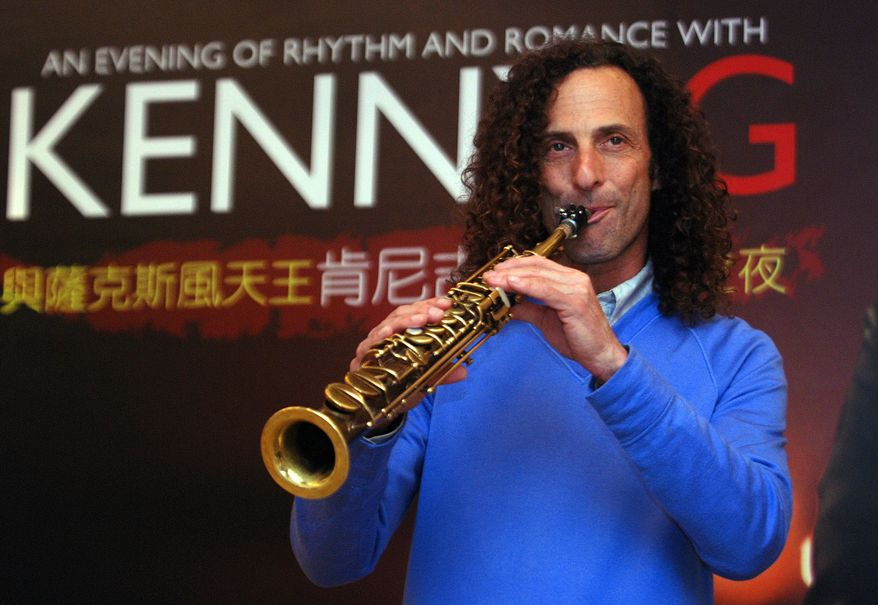 Jazz saxophonist Kenny G, whose real name is Kenneth Gorelick, performs on May 14, 2010, at a media event to promote a concert in Taipei, Taiwan. (AP Photo/Chiang Ying-ying)