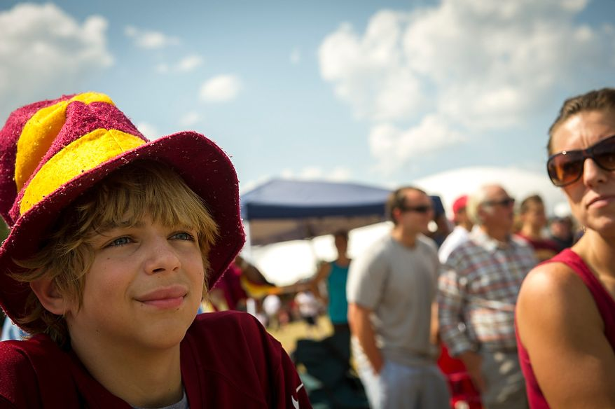 Redskins fan Keith McCoy,13, of Raleigh, N.C. watches the action from the sideline during the Redskins training camp at Redskins Park in Ashburn, Va., Monday, August 13, 2012. (Rod Lamkey Jr./The Washington Times)