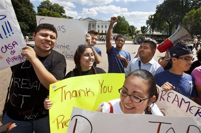 **FILE** Members of the group Casa de Maryland rally June 15, 2012, outside the White House in Washington to support President Obama's announcement that the U.S. government will stop deporting and begin granting work permits to younger illegal immigrants who came to the U.S. as children and have since led law-abiding lives. (Associated Press)