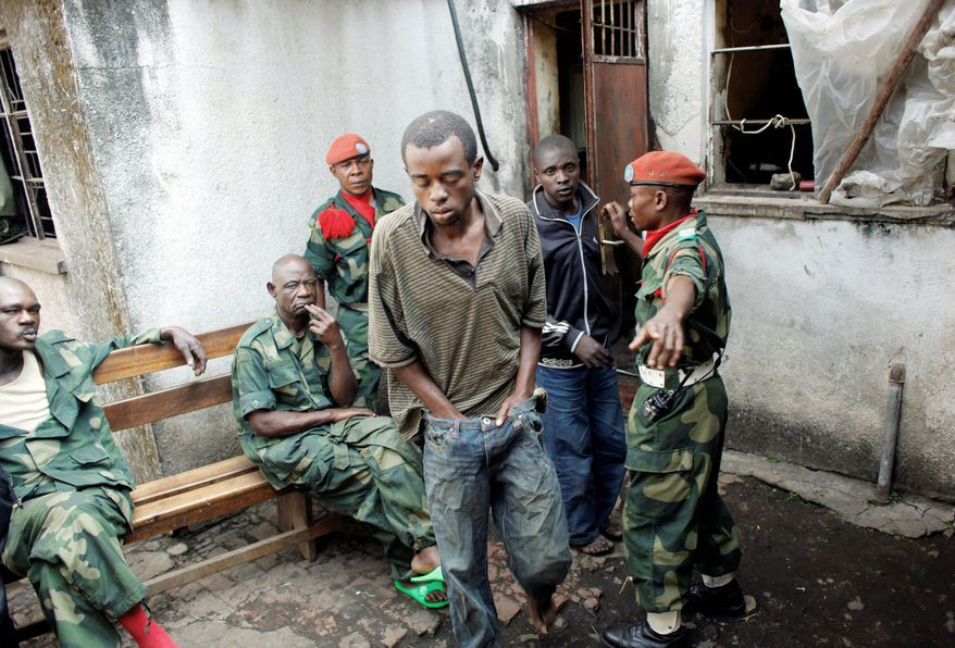 Ibrahim Nsanzimana is led out of his overcrowded jail at the Congolese military intelligence offices in Goma, eastern Congo, on Friday. (Associated Press)