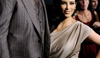 Kim Kardashian and Kris Humphries, seen here in happier times in August 2011, were married for 72 days when she filed for divorce. (Associated Press)