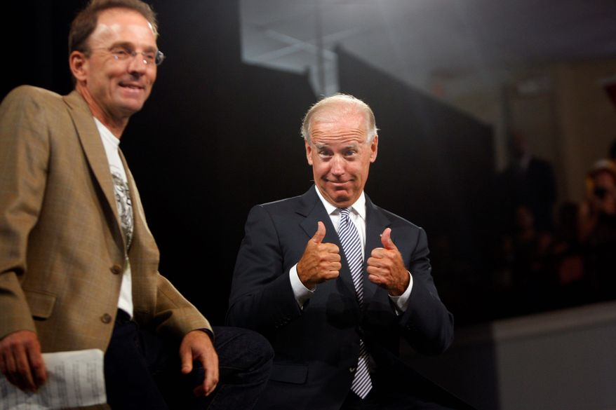 Vice President Joe Biden gives two thumbs up Monday, Aug. 13, 2012, during a rally at the Durham Armory in Durham, N.C. (AP Photo/The News & Observer, Travis Long)