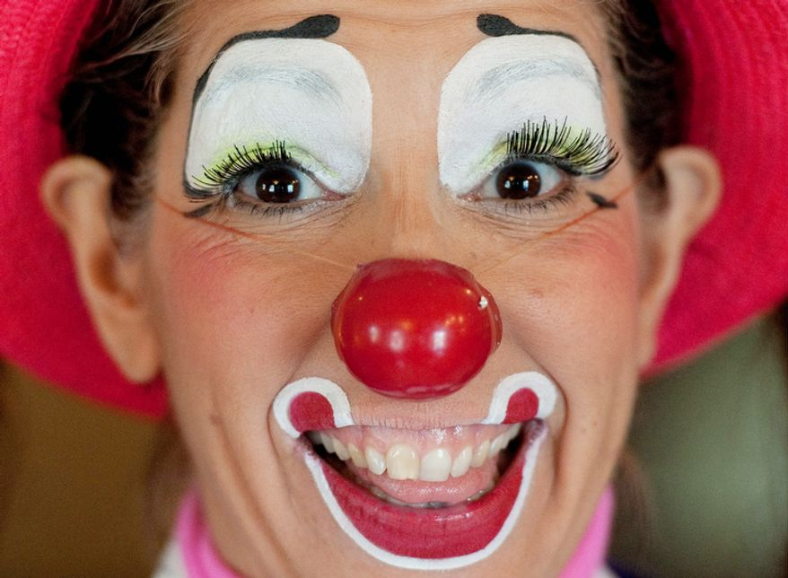 "Julie Varholdt, aka ""Lovely Buttons,"" poses for a portrait at the third annual Clown Campin' in Ontario, Calif. The week long event is held for clowns across the United States and Canada to learn, get inspired, and network. (AP Photo/Grant Hindsley)"