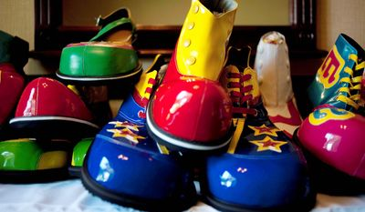 """Clown shoes are for sale at Jose Morales's, or """"Cascarita"""" the clowns' table in the dealer room at the third annual Clown Campin' in Ontario, Calif. (AP Photo/Grant Hindsley)"""