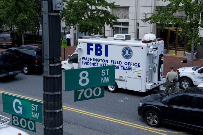 FBI and Metropolitan Police Department officials surround the Family Research Council building at 8th and G streets N.W. in Washington, D.C., on Wednesday, Aug. 15, 2012, following the shooting of a security guard at the conservative Christian lobbying group. The security guard was evidently shot in the arm before he wrestled the gunman to the ground. The suspect has now been taken into custody. (Barbara L. Salisbury/The Washington Times)