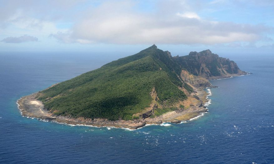 Uotsuri Island, one of the East China Sea islands known as Senkaku in Japanese and Diaoyu in Chinese, is claimed by Japan, China and Taiwan. (AP Photo/Kyodo News)