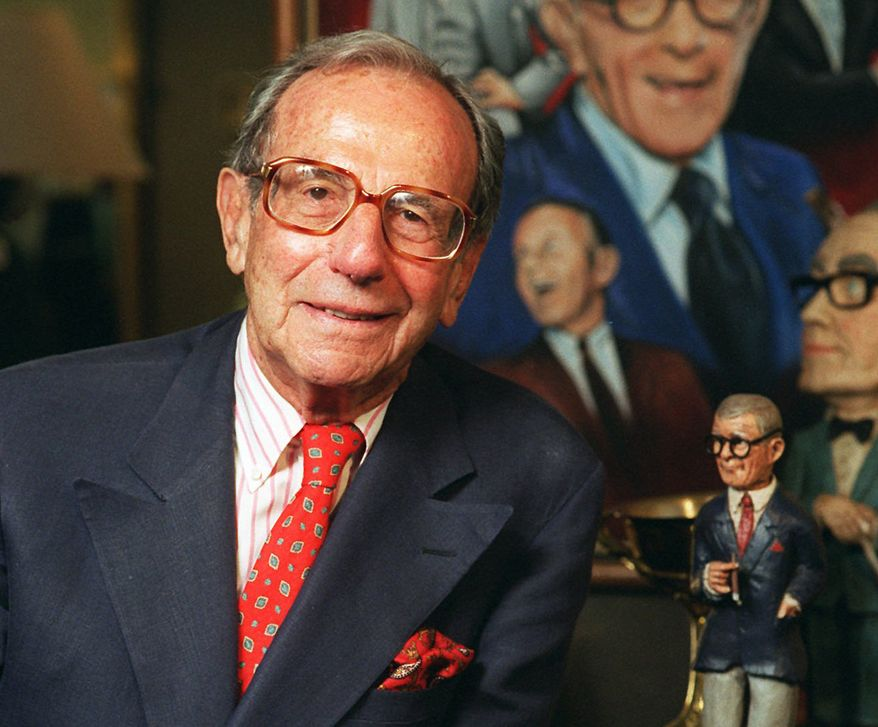 Irving Fein, longtime manager of George Burns and Jack Benny, stands near memorabilia up for auction at Sotheby's in Beverly Hills, Calif., in 1996. (AP Photo/Frank Wiese)