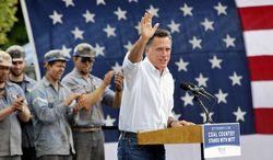 Republican presidential candidate Mitt Romney waves Aug. 14, 2012, to the crowd during a rally at the Century Mine Main Office Building near Beallsville, Ohio. (Associated Press/The Intelligencer)