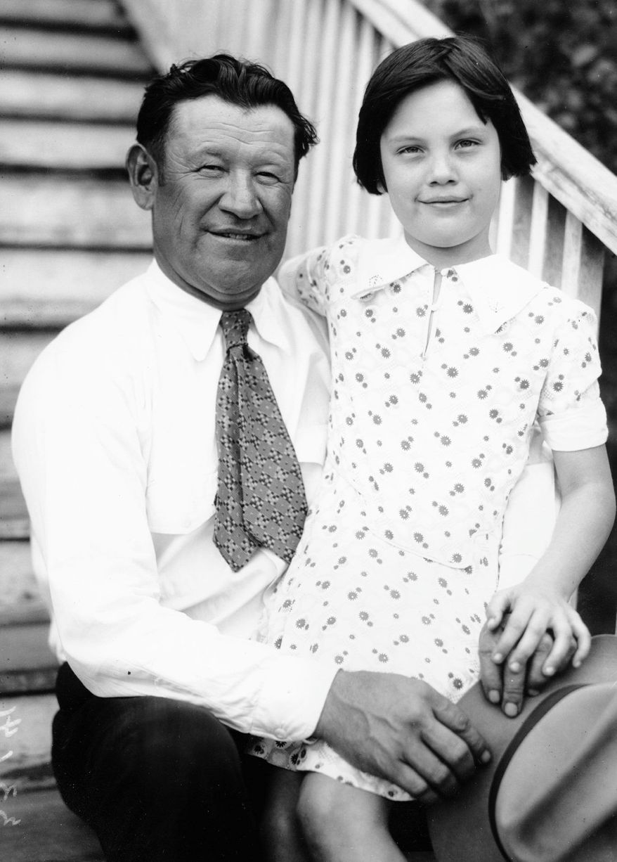 Jim Thorpe visits his daughter, Grace, at the Haskell Institute, the American Indian School, in Lawrence, Kansas, in February 1931. Thorpe was married three times. He died in 1953. (Associated Press)