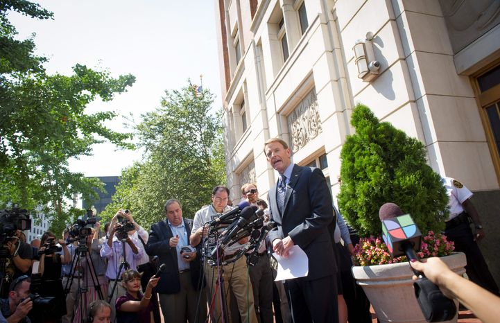 Family Research Council President Tony Perkins exits the Family Research Council headquarters on Thursday to accuse ideological opponents of using language that inspires the type of violence that occurred in