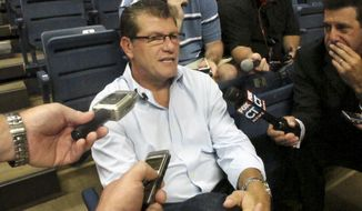 Connecticut women's basketball coach Geno Auriemma speaks with reporters at Gampel Pavilion, in Storrs, Conn., Thursday, Aug. 16, 2012. Auriemma said he has no interest in returning in 2016 as coach of the U.S. Olympic women's basketball team. (AP Photo/Pat Eaton-Robb)