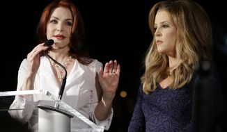 "Priscilla Presley (left) and Lisa Marie Presley speak to fans at a candlelight vigil at Graceland, Elvis Presley's home, on Wednesday, Aug. 15, 2012, in Memphis, Tenn. Fans from around the world were at Graceland to commemorate the 35th anniversary of ""the king's"" death. (AP Photo/Mark Humphrey)"
