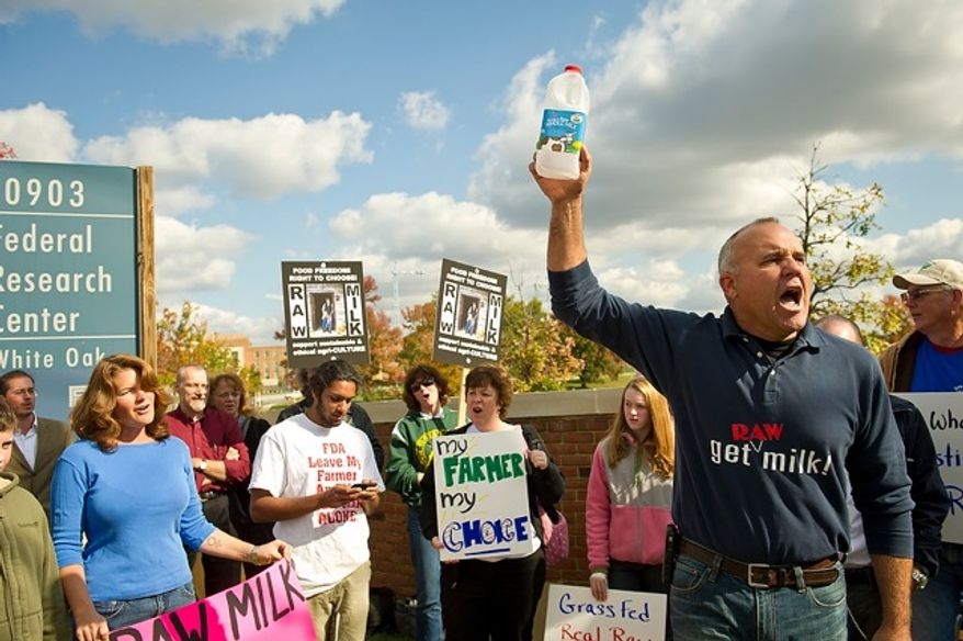 **FILE** Mark McAfee (right), founder of Fresno, Calif.-based Organic Pastures Dairy, leads a Nov. 1, 2011, protest in front of the Food and Drug Administration headquarters in Silver Spring, Md., against the FDA's ban on interstate transport of raw milk. (Rod Lamkey Jr./The Washington Times)