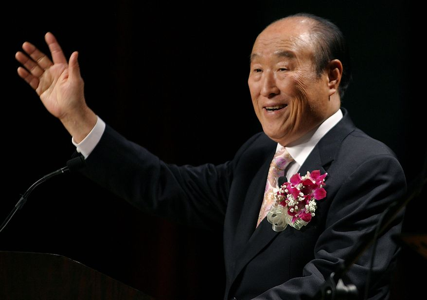 """Unification Church leader Rev. Sun Myung Moon speaks during his """"Now is God's Time"""" rally in New York, Saturday, June 25, 2005. Billy Graham is also hosting a religious event in New York this weekend. (AP Photo/John Marshall Mantel)"""