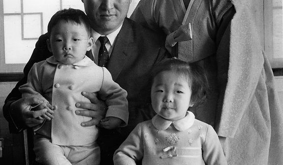 The Rev. Sun Myung Moon with his wife Hak Ja Han Moon and his eldest son Hyo Jin Moon, left, and eldest daughter Ye Jin Moon circa mid 1960s. Courtesy H.S.A.-U.W.C.