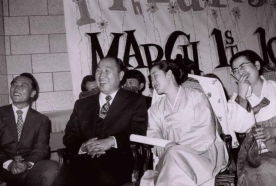The Rev. Sun Myung Moon with his wife Hak Ja Han Moon with disciples.  Courtesy H.S.A.-U.W.C.