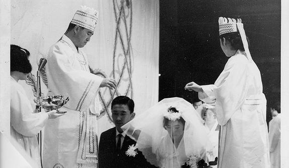 The Rev. Sun Myung Moon with his wife Hak Ja Han Moon conduct marriage blessing ceremony. Courtesy H.S.A.-U.W.C.