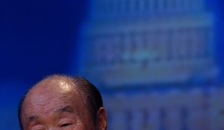 The Rev. Sun Myung Moon speaks during the Common Legacy Breakfast Summit in Washington on Dec. 13, 2004. (The Washington Times )