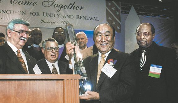 The Reverand Sun Myung Moon accepts an award from special committee of clergy  after he addressed The Inaugural Prayer Luncheon for Unity and Renewal at The Hyatt regency Hotel in Washington, DC, January 19, 2001. ( J.M. Eddins Jr. / The Washington Times )