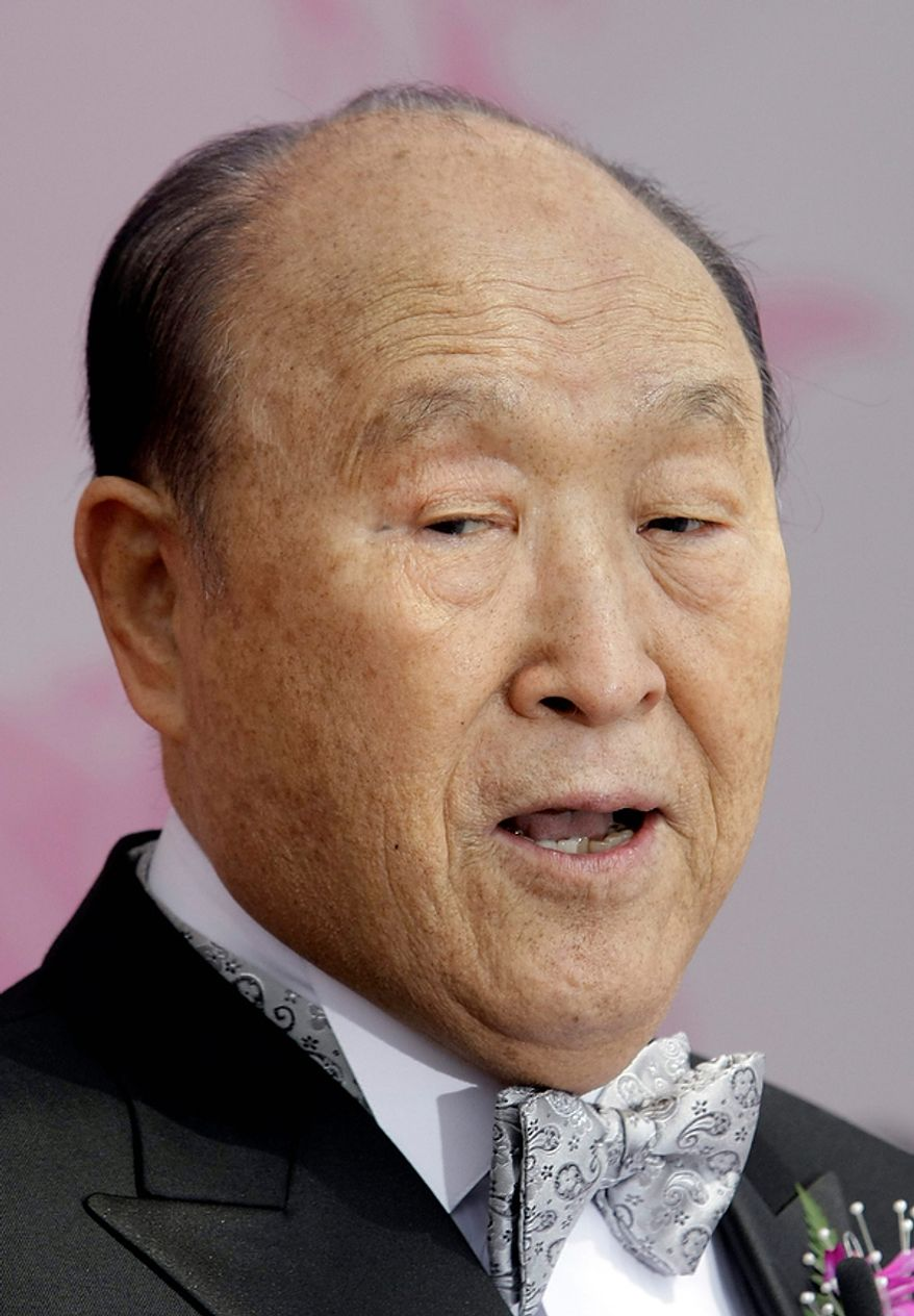 The 89-year-old Rev. Sun Myung Moon, the controversial founder of the Unification Church, delivers a speech during the mass wedding ceremony arranged by the church at Sun Moon University in Asan, south of Seoul, South Korea, Wednesday, Oct. 14, 2009. It was the church's biggest mass wedding in a decade, a spectacle church officials said involves 40,000 people around the world. (AP Photo/ Lee Jin-man)