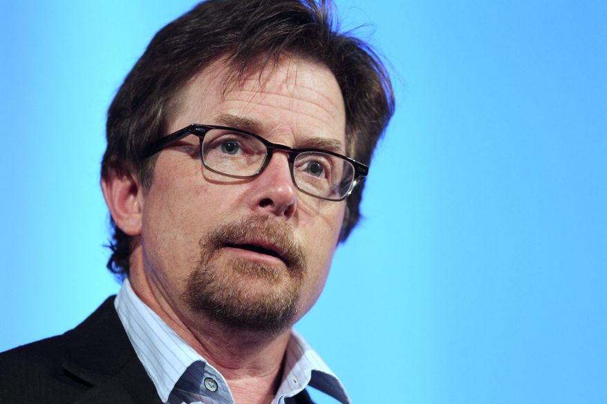**FILE** Actor Michael J. Fox speaks June 15, 2012, at the Middlesex Community College Celebrity Forum in Lowell, Mass. (Associated Press)