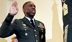 ** FILE ** In this May 26, 2006, file photo, Army Lt. Gen. William E. Kip Ward is administered the oath of four-star General, the Army's highest rank of general, by Command Sgt. Major Mark Ripka, right, at Fort Myer, Va. (AP Photo/Caleb Jones, File)