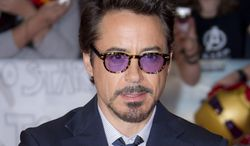 """** FILE ** In this April 19, 2012, file photo, actor Robert Downey Jr. arrives for the European Premiere of """"The Avengers,"""" in London. Representatives at Marvel Entertainment announced that Downey Jr. sustained an injury to his foot while performing a stunt on the set of """"Iron Man 3."""" (AP Photo/Joel Ryan, file)"""