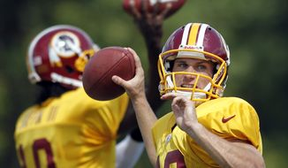 Washington Redskins quarterback Kirk Cousins throws Aug. 13, 2012, during training camp at Redskins Park in Ashburn, Va. (Associated Press)