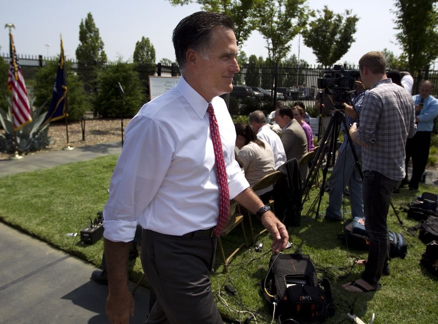 Republican presidential candidate Mitt Romney leaves Aug. 16, 2012, after a news conference at Spartanburg International Airport in Greer, S.C. (Associated Press)