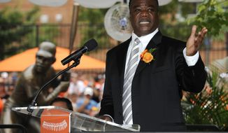 FILE - In this Aug. 11, 2012 file photo, former Baltimore Oriole Eddie Murray speaks at a ceremony to unveil a statue in his likeness before a baseball game between the Orioles and the Kansas City Royals in Baltimore. The Securities and Exchange Commission announced that Murray has agreed to settle federal civil charges of profiting in stock trades by using confidential information passed to him by a former teammate. (AP Photo/Nick Wass, File)
