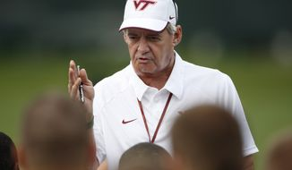 This Tuesday, Aug. 7, 2012 photo,  Virginia Tech head coach Frank Beamer addresses his team during NCAA college football practice in Blacksburg, Va.(AP Photo/The Roanoke Times, Daniel Lin) LOCAL TV OUT LOCAL INTERNET OUT LOCAL PRINT OUT