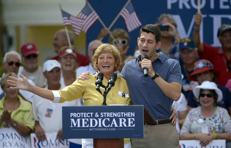 Rep. Paul Ryan, the Republican vice presidential candidate, introduces his mother, Betty Ryan Douglas, to supporters Aug. 18, 2012, at a campaign rally in The Villages, Fla. (Associated Press)