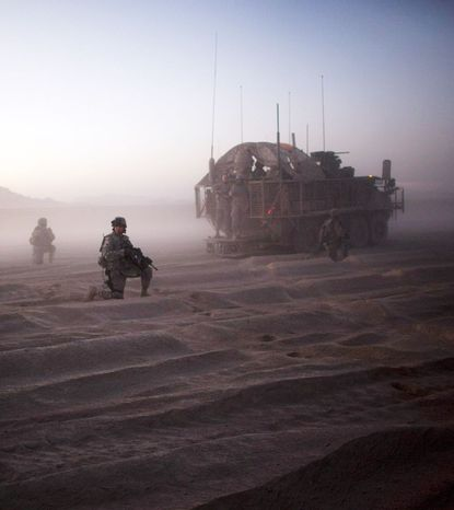 U.S. soldiers from the 5th Stryker Brigade patrol near Spin Boldak, Afghanistan, in August 2009. That October, seven soldiers died when an improvised explosive device blew up a Stryker vehicle. (Associated Press)