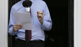 ** FILE ** Julian Assange, founder of WikiLeaks, makes a statement from a balcony of the Ecuadorean Embassy in London on Sunday, Aug. 19, 2012. (AP Photo/Kirsty Wigglesworth)