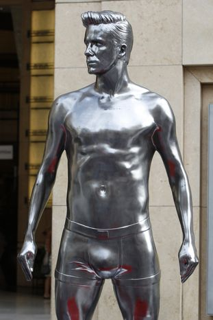 A statue of English soccer player David Beckham is seen Aug. 17, 2012, in the Hollywood section of Los Angeles. The statue, sporting designer underwear, is making appearances around New York City, Los Angeles and San Francisco. (Associated Press)