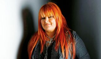 Country singer Wynonna Judd poses for a portrait at the Gibson Guitar Lounge during the Sundance Film Festival in Park City, Utah, in January 2009. (AP Photo/Mark Mainz)