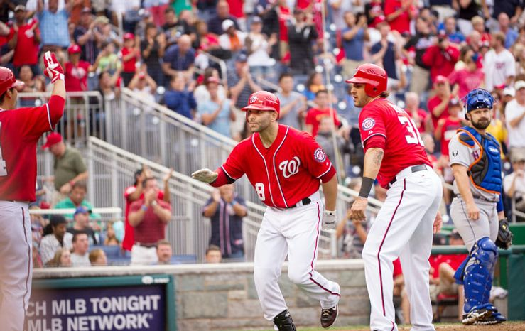 Washington Nationals Danny Espinoza (8) is greeted at the plate by Michael Morse (38) after his two-run home run in the bottom of the second inning. (Rod Lamkey Jr./The Washington Times)