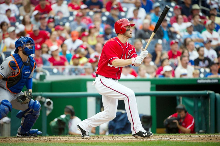 Washington Nationals Bryce Harper (34) watches the ball as he hits an RBI triple, scoring Jayson Werth in the bottom of the third inning. (Rod Lamkey Jr./The Washington Times)