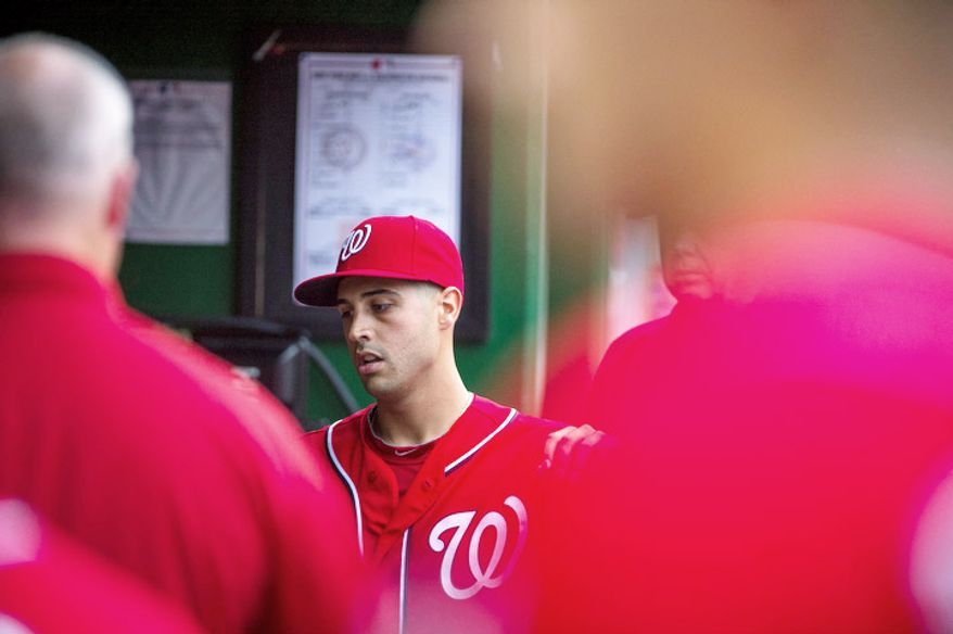 Washington Nationals pitcher Gio Gonzalez walks through the dugout after ending the inning as the Washington Nationals host the New York Mets at Nationals Park. (Rod Lamkey Jr./The Washington Times)