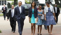 President Obama, first lady Michelle Obama (right) and daughters Malia (second from left) and Sasha walk from the White House to St. John's Episcopal Church to attend services on Sunday, Aug. 19, 2012, in Washington. (AP Photo/Manuel Balce Ceneta)