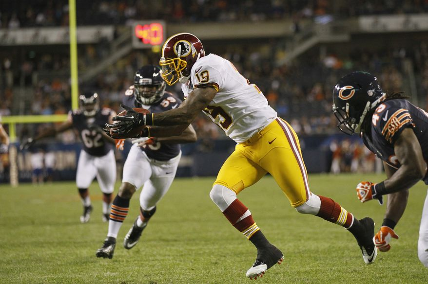 Washington Redskins wide receiver Dezmon Briscoe (19) makes a catch against the Chicago Bears in the second half of an NFL preseason football game in Chicago on Saturday, Aug. 18, 2012. The Bears won 33-31. (AP Photo/Charles Rex Arbogast)