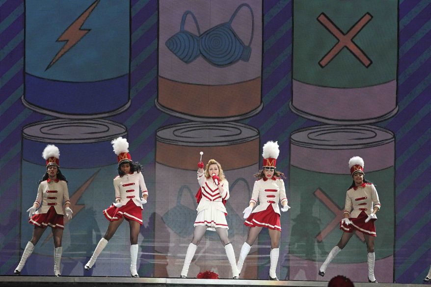 Madonna (center) performs at Olympic Hall in Moscow on Tuesday, Aug. 7, 2012. (AP Photo/Mikhail Metzel)