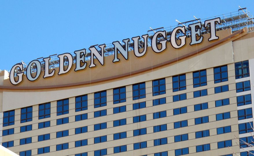 The Golden Nugget Atlantic City is suing a group of gamblers who won $1.5 million in an April game of mini-baccarat. The casino says the eight decks of cards were not shuffled by the manufacturer before being placed into use. (Associated Press)